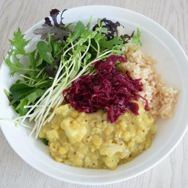 Cauliflower dahl served with brown rice, greens, pea shoots and sauerkraut